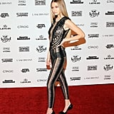 Wearing a barely there Julien Macdonald jumpsuit at a Sports Illustrated Swimsuit celebration.