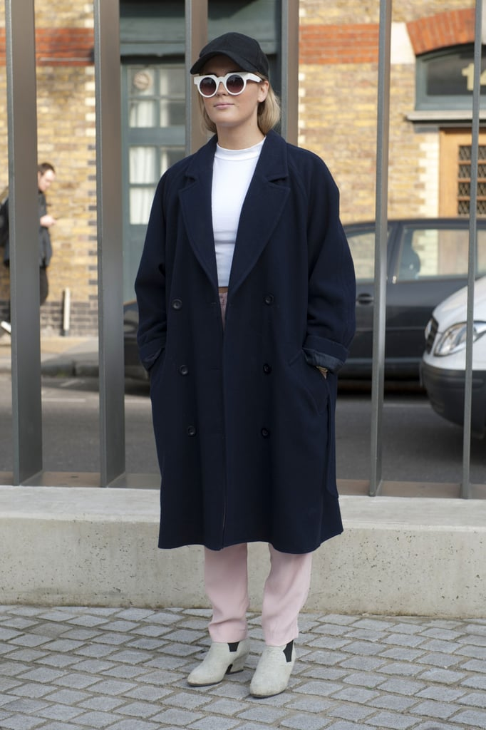 A sharp, oversize coat pulled this showgoer's crop top and pastel trousers together.