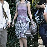 Carey Mulligan carried her hat to set.