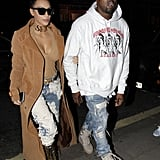 "When Kim stepped out in a daring denim look — complete with a ""sex"" choker! —and Kayne wore a graphic white hoodie."