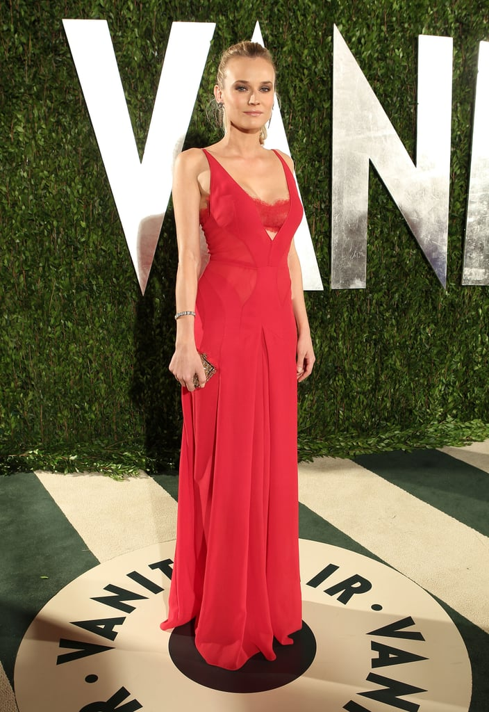 Never one to shy away from a stylish arrival, Diane Kruger wowed in this peekaboo red gown by Calvin Klein at the Vanity Fair Oscar party. Her siren silhouette was emphasized by the lacy bra and gold clutch.