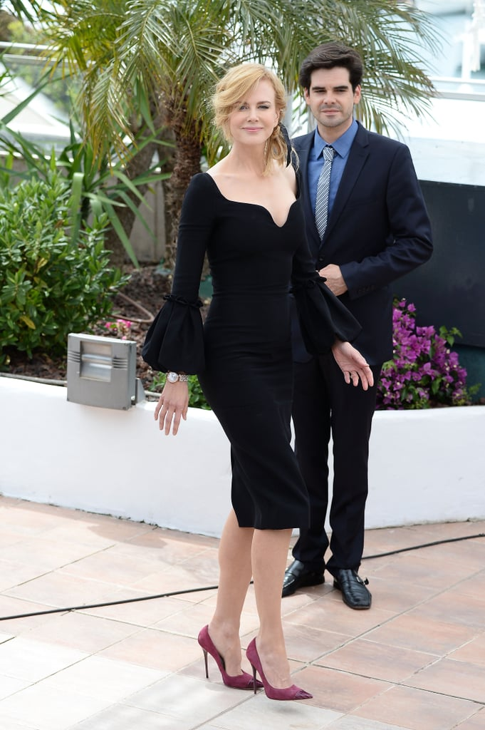 Nicole Kidman's second look at Cannes — a sleek, black dress from Alexander McQueen — debuted during the jury photocall. For an added pop of color, she accessorized her dress with pink stilettos.
