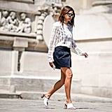 Summer temperatures calls for a lightweight blouse, miniskirt, and sandals at the office.