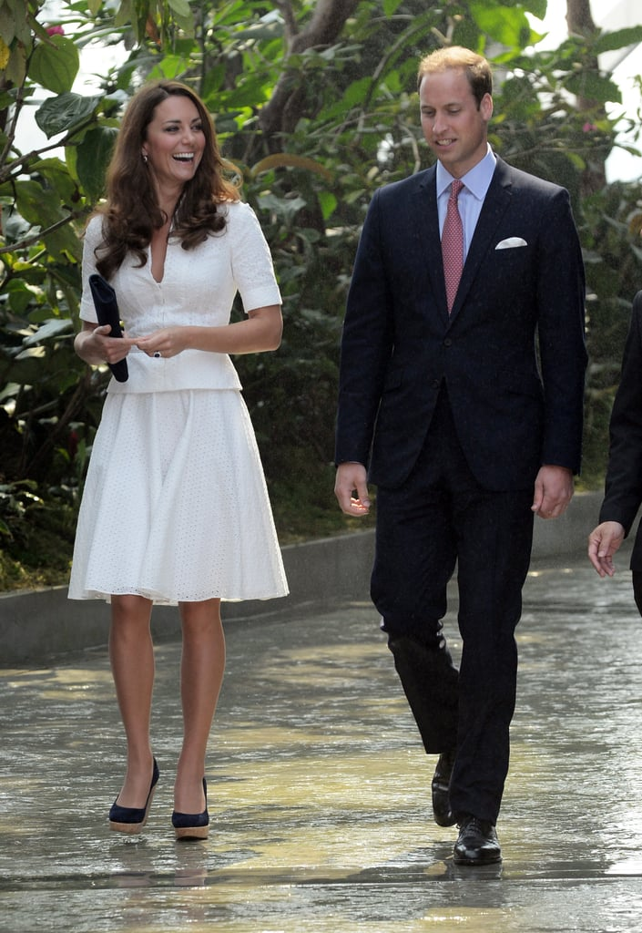 The Duchess of Cambridge repeated her crisp white Alexander McQueen ensemble — seen first at the Order of the Garter service — for an appearance in Singapore during their Diamond Jubilee tour.