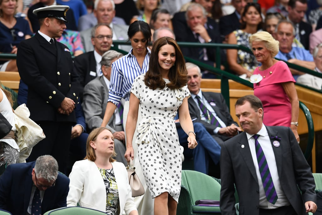 Meghan followed Kate's lead as they took their seats at Wimbledon.