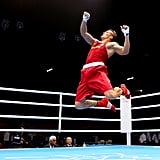 Ukraine's Oleksandr Usyk jumped in the air after winning his boxing bout.