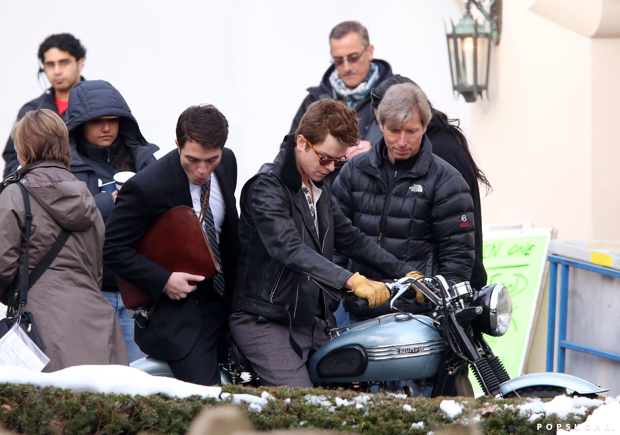 Stage One: How Many People Does It Take to Get Two Guys on a Motorcycle?