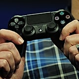 Meet the PlayStation 4's new controller, the Dual Shock 4, which has enhanced rumble features, a touchpad, a headphone jack, a share button, and a light bar. It also works with a PlayStation camera for motion-controlled gaming.
