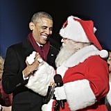 Barack Obama shook hands with Santa Claus during the lighting of the Christmas tree in Washington.