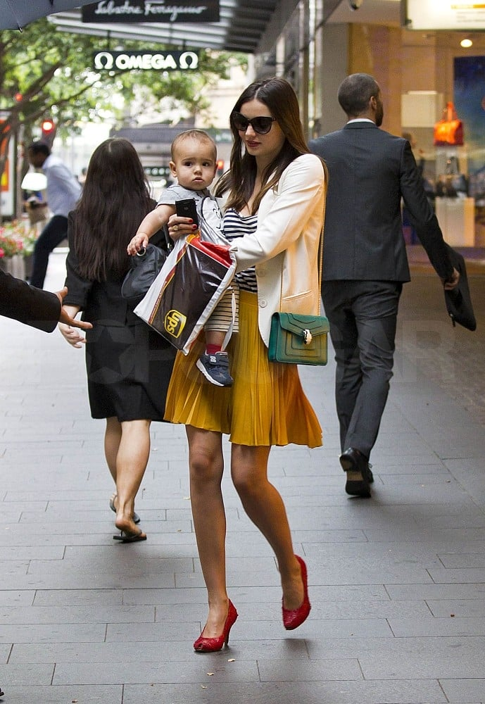 Miranda Kerr put together a ladylike look while out with baby Flynn.