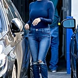 Reworking basic denim with a sleek long-sleeve top and open-toed booties.