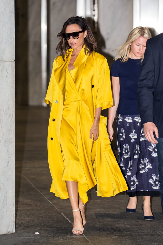 e745ee1eb2605f Wearing a monochrome yellow outfit in June 2016. | Victoria Beckham ...