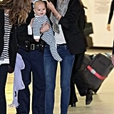 Baby Flynn was all smiles getting off the plane.