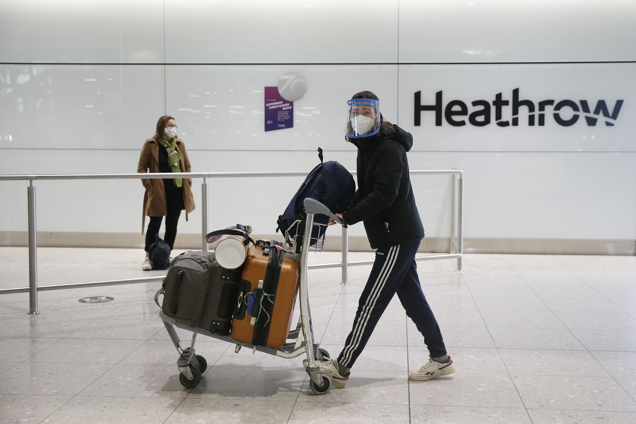 LONDON, ENGLAND - JANUARY 30: Travelers arrive at Heathrow Terminal 2 on January 30, 2021 in London, England. The UK government has added flights from the UAE to the