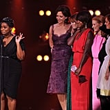 The cast of The Help accepts their award.