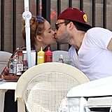 Lauren Conrad and boyfriend William Tell enjoyed a kiss at Nick's Coffee Shop in LA in June.