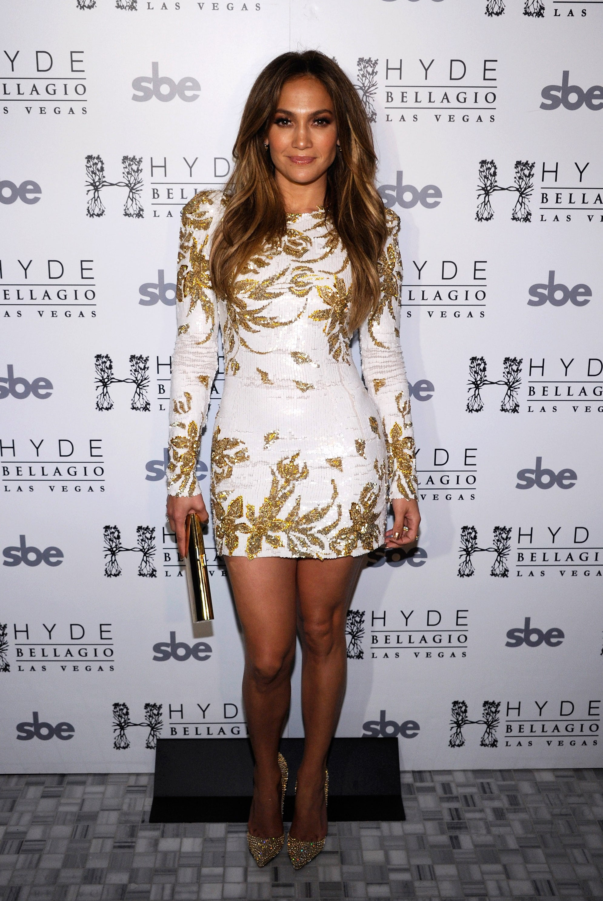 """Miss Lopez donned a gilded Zuhair Murad minidress for the launch of her single """"Goin' In"""" in Las Vegas in May 2012."""
