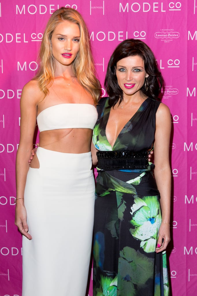 Rosie Huntington-Whiteley and Dannii Minogue — both Modelco ambassadors — struck a pose in front of the media wall at a welcome party thrown for Rosie on Hayman Island on July 10. Photo credit: Caroline McCredie