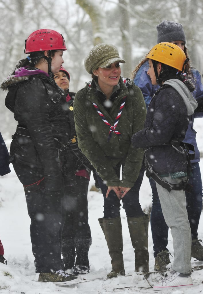 Kate braved the wind and snow to spend time with a group of young scouts at a British campsite in March 2016.