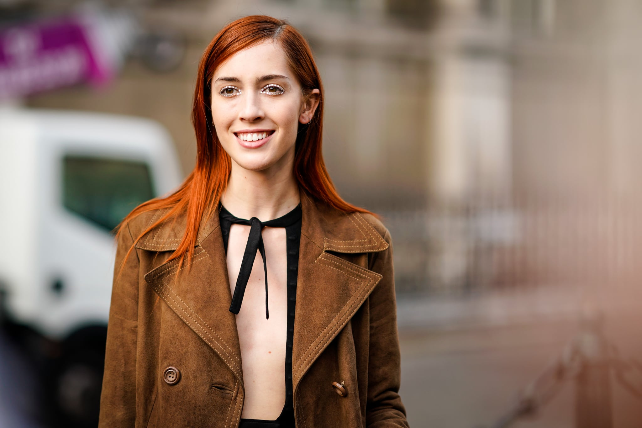 PARIS, FRANCE - SEPTEMBER 27:  Teddy Quinlivan, model, wears a brown suede trench coat, outside the Dries Van Noten show, during Paris Fashion Week Womenswear Spring/Summer 2018, on September 27, 2017 in Paris, France.  (Photo by Edward Berthelot/Getty Images)