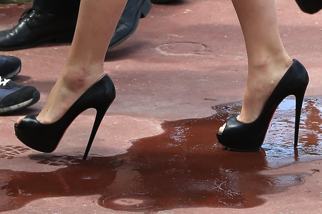 Carey Mulligan wore black Christian Louboutin peep-toe pumps.