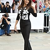 Penelope Cruz showed off her figure in fitted black pants and a sweater.