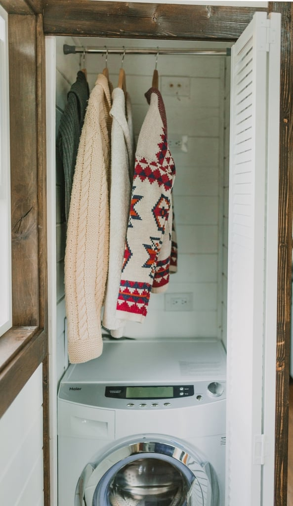 The home's washer/dryer combo unit can be concealed with a foldable door.  Want even more small-space living inspiration? Check out these links! How to Live Stylishly in a Studio Apartment 5 Rooms That Prove Bigger Isn't Always Better 7 Sneaky Ways to Add More Square Footage Small Apartment? There's a DIY For That!