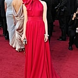She opted for this dramatic fuchsia-hued, bow-tie Giambattista Valli Couture gown for the 2012 Oscars.
