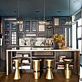 The kitchen's custom backsplash and flashy stools give it a one-of-a-kind edge.