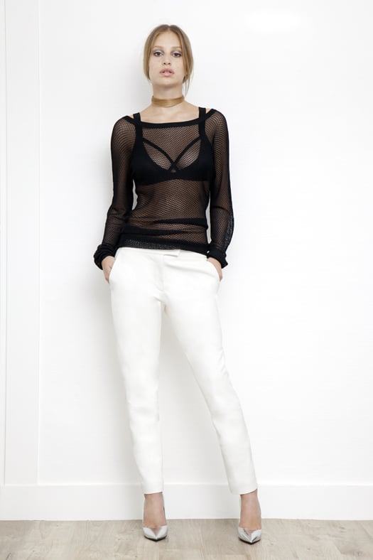 Viscose Sports Bra in Black, Fishnet Long Sleeve Sweater in Black, Slim Pant in Cream, Addiction Pump in Specchio. Photo courtesy of Tamara Mellon