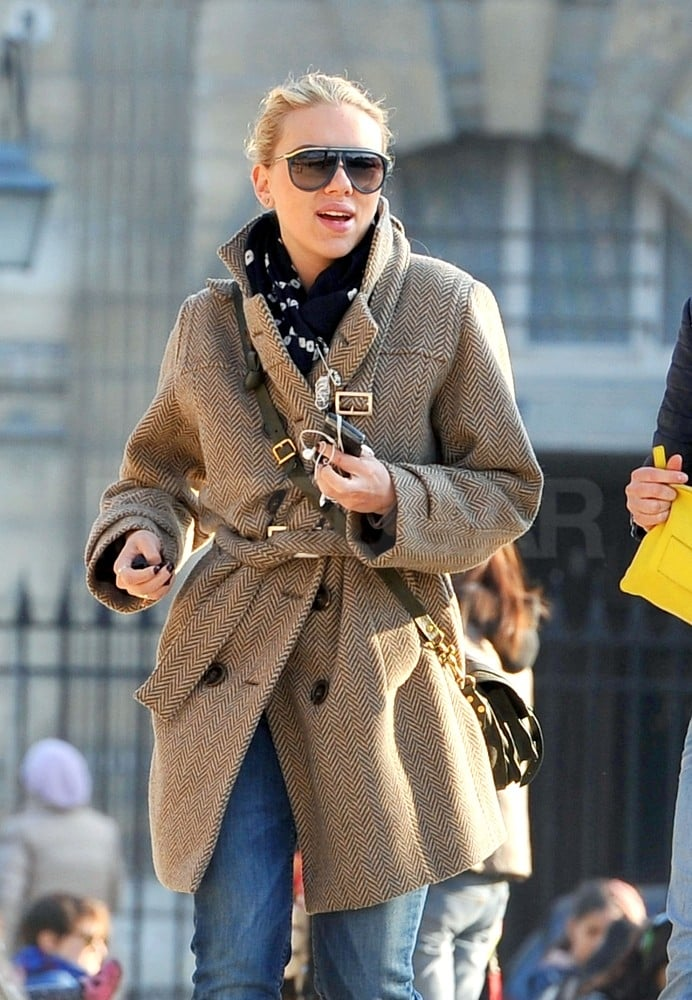 Scarlett Johansson spent the afternoon exploring the Marais district in Paris yesterday with a pair of female friends. The actress appeared to be enjoying a break from work before she begins her press tour for The Avengers next month. Scarlett was seen relaxing on the lawn at the Place des Vosges square, shopping at the high-end boutique L'Eclaireur, and visiting an exhibit at the Swedish Institute. The star was bundled up in a tweed coat and scarf for the chilly Parisian weather and was without her most recent love interest Nate Naylor during her day in the city. The pair were spotted getting cozy in NYC in January and also took a weeklong vacation to Hawaii together in February, but they haven't yet stepped out publicly. Instead, Scarlett brought her little brother as her date for her latest photo op, at a fundraiser for Barack Obama in the Big Apple last month.
