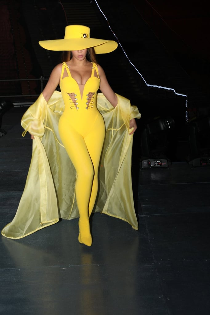 "The On the Run II tour may have ended months ago, but Beyoncé's incredible onstage costumes keep coming. The singer recently performed at the Global Citizen Festival in Johannesburg, South Africa, and wore six — yes, six — different outfits, including an electrifying Versace jumpsuit.  For a special performance of ""Formation,"" Beyoncé wore the yellow jumpsuit featuring front cutouts held together by the brand's iconic safety pins. Her dancers wore the same jumpsuit in different colors, collectively forming a powerful rainbow. They each accessorized the jumpsuit with a matching wide-brimmed hat and elbow-length gloves — all things Carmen Sandiego wouldn't not wear. That same evening, Versace coincidentally held its Pre-Fall 2019 show in New York, where plenty of safety pins abounded.      Related:                                                                                                           Beyoncé Wore So Many Amazing Outfits in 2018, We're Breaking a Sweat Trying to Keep Up"