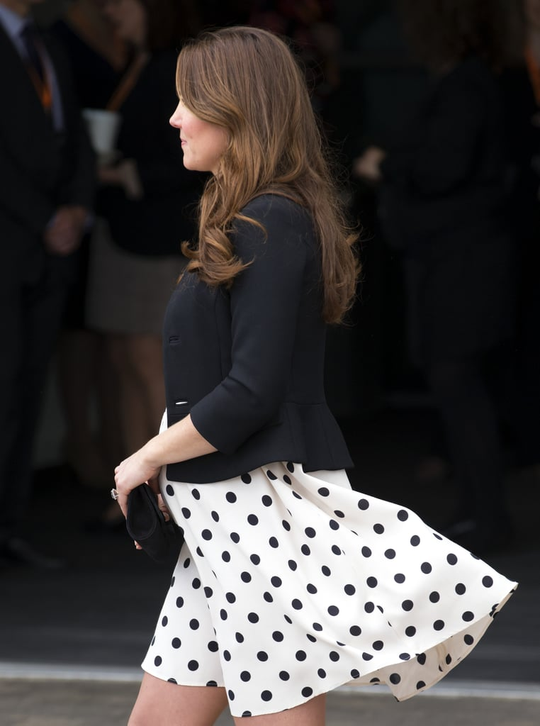 Back in April 2013 when she was pregnant with Prince George, the polka-dot Topshop dress Kate wore flew up a bit in the back — but she played it cool.