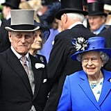 The queen laughed with her husband at the derby.