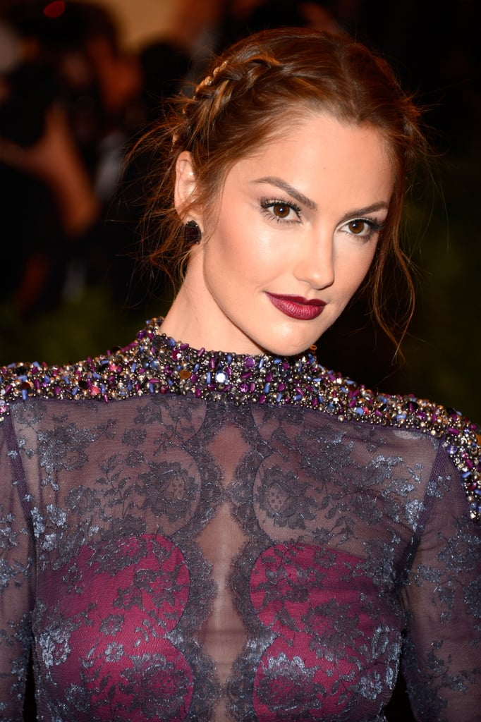 Minka Kelly's tousled braid paired for a sultry look that matched her purple ensemble perfectly at this year's Met Gala.