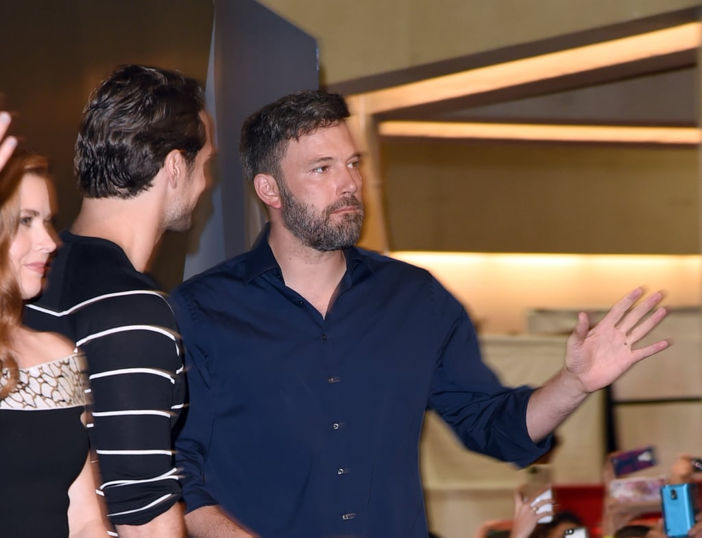 Although Ben Affleck sported his wedding ring when he hit the stage at Comic-Con on Saturday, it looks like he didn't wear it for long. The actor joined his Batman v Superman: Dawn of Justice co-stars in San Diego, and during the panel, he was all smiles, wearing his wedding ring as he addressed the audience. In other pictures from the same day, though, Ben is seen without his wedding ring, and on Monday, Ben was spotted without his ring again when he was walking around in Santa Monica. Ben and Jennifer Garner announced their split on June 30, and after they spent time with their kids in the Bahamas that week, the pair got back to work. Jennifer was spotted wearing her wedding ring while out and about in Atlanta over the weekend, looking casual while in town to work on a new movie. Keep reading for more pictures of Ben at Comic-Con, then check out Ben's lower back tattoo.