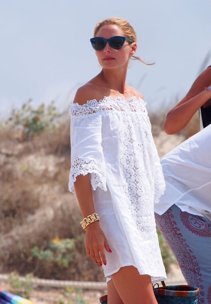 Olivia's hair was pulled back to reveal her lace-embroidered off-the-shoulder neckline.