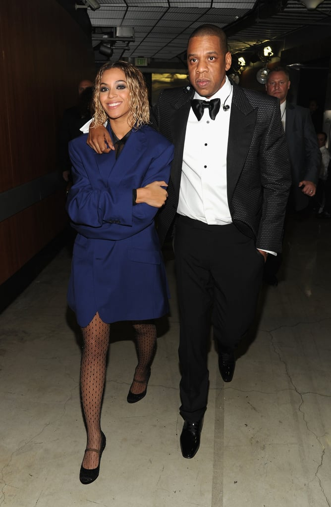 Jay Z threw his arm — and coat — around his lady after their showstopping performance at the Grammys in January 2014.