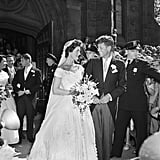 "Jackie reportedly wasn't a fan of her wedding dress.  The gown was made up of 50 yards of fabric complete with an heirloom rose point lace veil. According to Time, Jackie ""had wanted a simple dress with sleek, straight lines, but bowed to family pressure to wear something more traditional despite thinking it looked like a lampshade."""