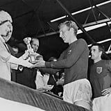 Queen Elizabeth II presents the Jules Rimet Cup to Bobby Moore in 1966