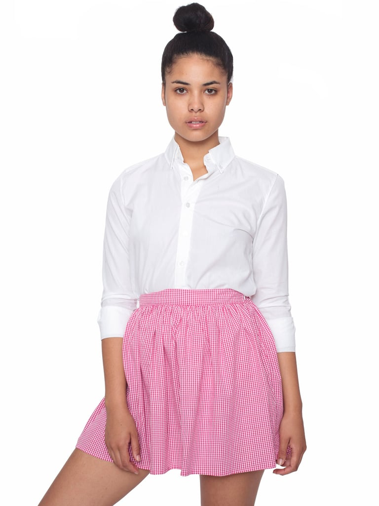 Slip into the trend with an everyday skirt style that you can mix and match with your printed tops or finish just like so, with a classic collared button-down.  American Apparel Gingham Full Woven Skirt ($38)