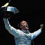 Artur Akhmatkhuzin of Russia cheered after beating Richard Kruse of Great Britain during the round of 32 men's foil individual.