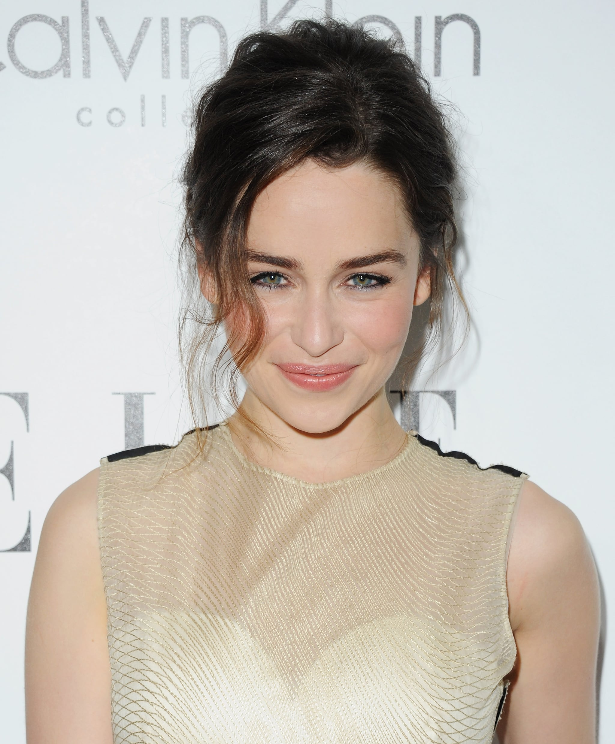 Game of Thrones actress Emilia Clarke turned to peachy makeup tones and a tousled updo.