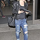 Mena Suvari has an iPad to keep her entertained at the airport.