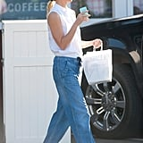 Gwyneth Paltrow Wearing a White Top and Loose Jeans