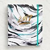 Paper Source Watercolor Demi Hidden Spiral 12-Month Planner ($33)