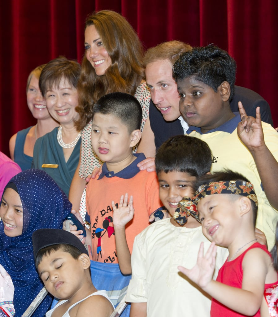 Kate Middleton and Prince William got together for a group photo with cute kids and their teachers during a visit to Singapore's Rainbow Center in September 2012.