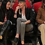 Charlize Theron's off-duty style had just the right amount of on-trend appeal, balancing a relaxed tee with more attention-grabbing pieces like cutout booties and her cool-girl hat.