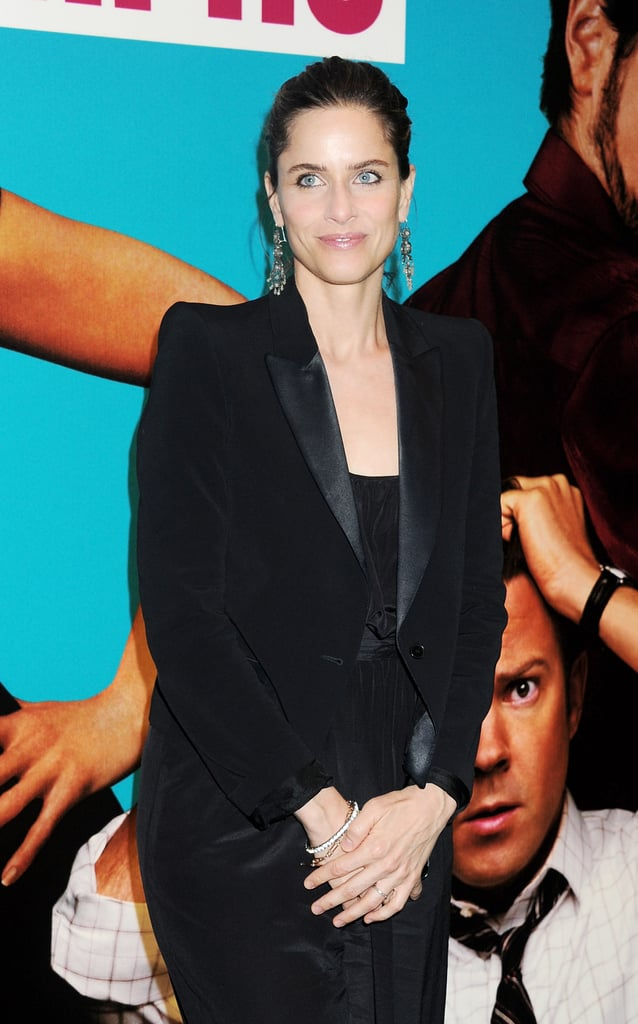 Amanda Peet in a black suit.