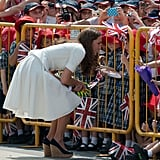 Even though she was separated by gates, Kate still made an effort to greet her small fans during a stop in Singapore in September 2012.